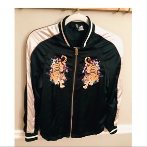 Rad bomber jacket featuring two tiger patches.